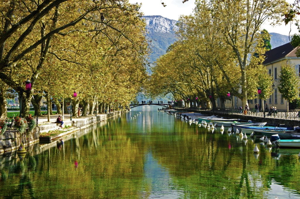 beautiful Pont des Amours (Bridge of Love) in Annecy, with reflection in water