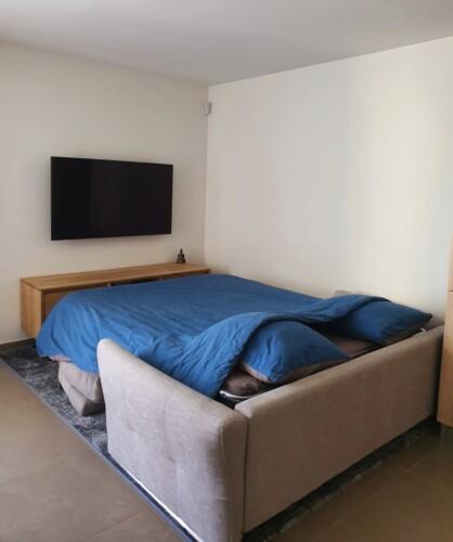 canape-lit dans appartement de vacances a Annecy